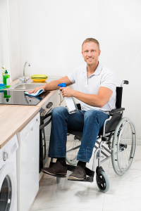 Man on wheelchair cleaning-